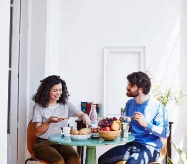 Photo of a couple having breakfast in their home, used on the Koosi website.
