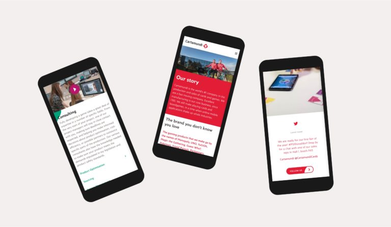 Various pages of Cartamundi's responsive websites, shown on three smartphones.
