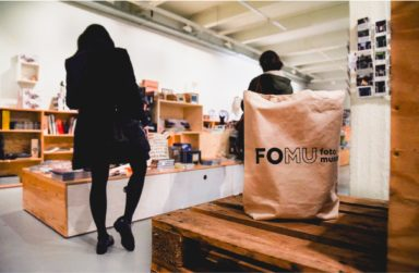 FOMU's new logo, seen on a tote bag in the museum shop.
