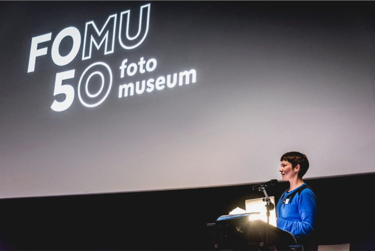 Wall projection of FOMU's 50 year anniversary logo variation.