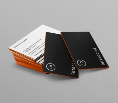 Interpoint's visual identity and logo on business cards.