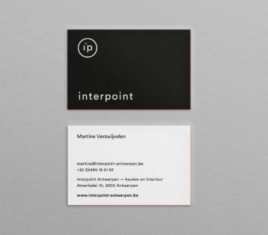 Interpoint's visual identity and logo seen on business cards 2.