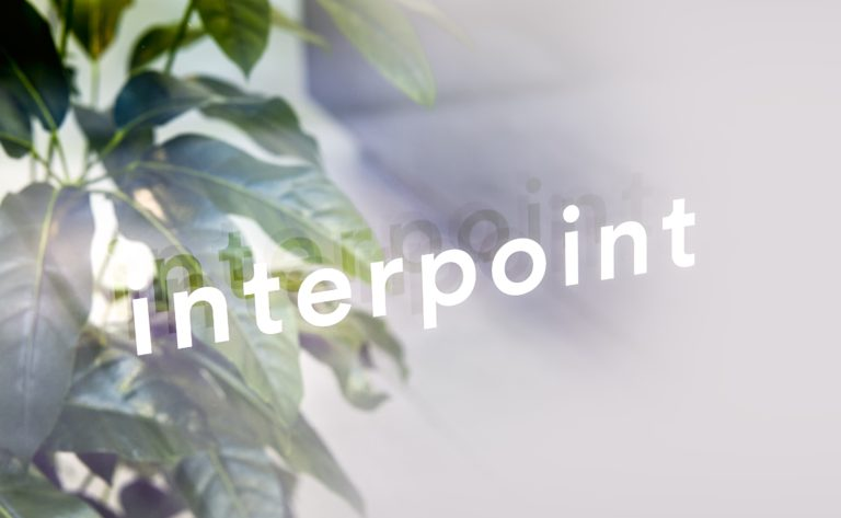 Interpoint's logotype on the Antwerp store window.
