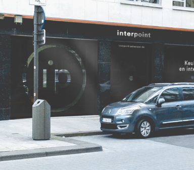 Interpoint word mark logo, brand mark logo, and visual identity on store exterior.